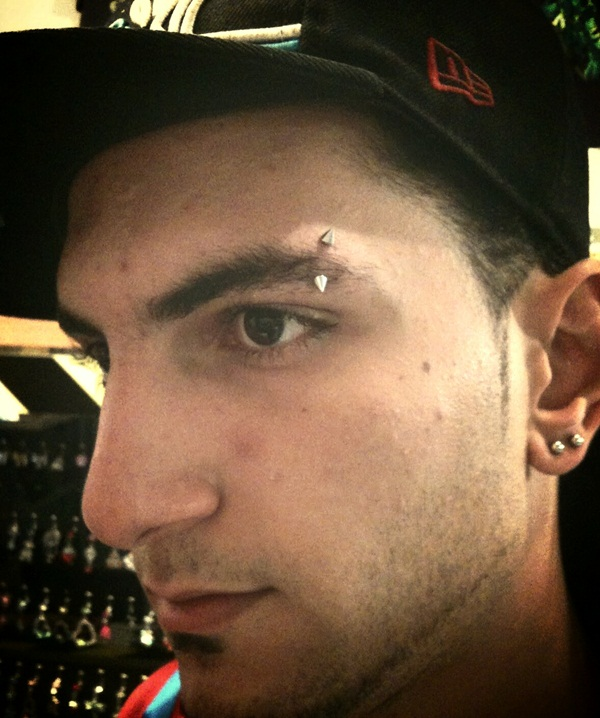 Eyebrow piercing designs10