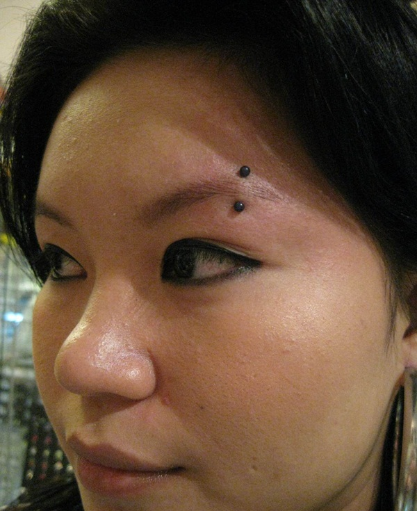 Eyebrow piercing designs12